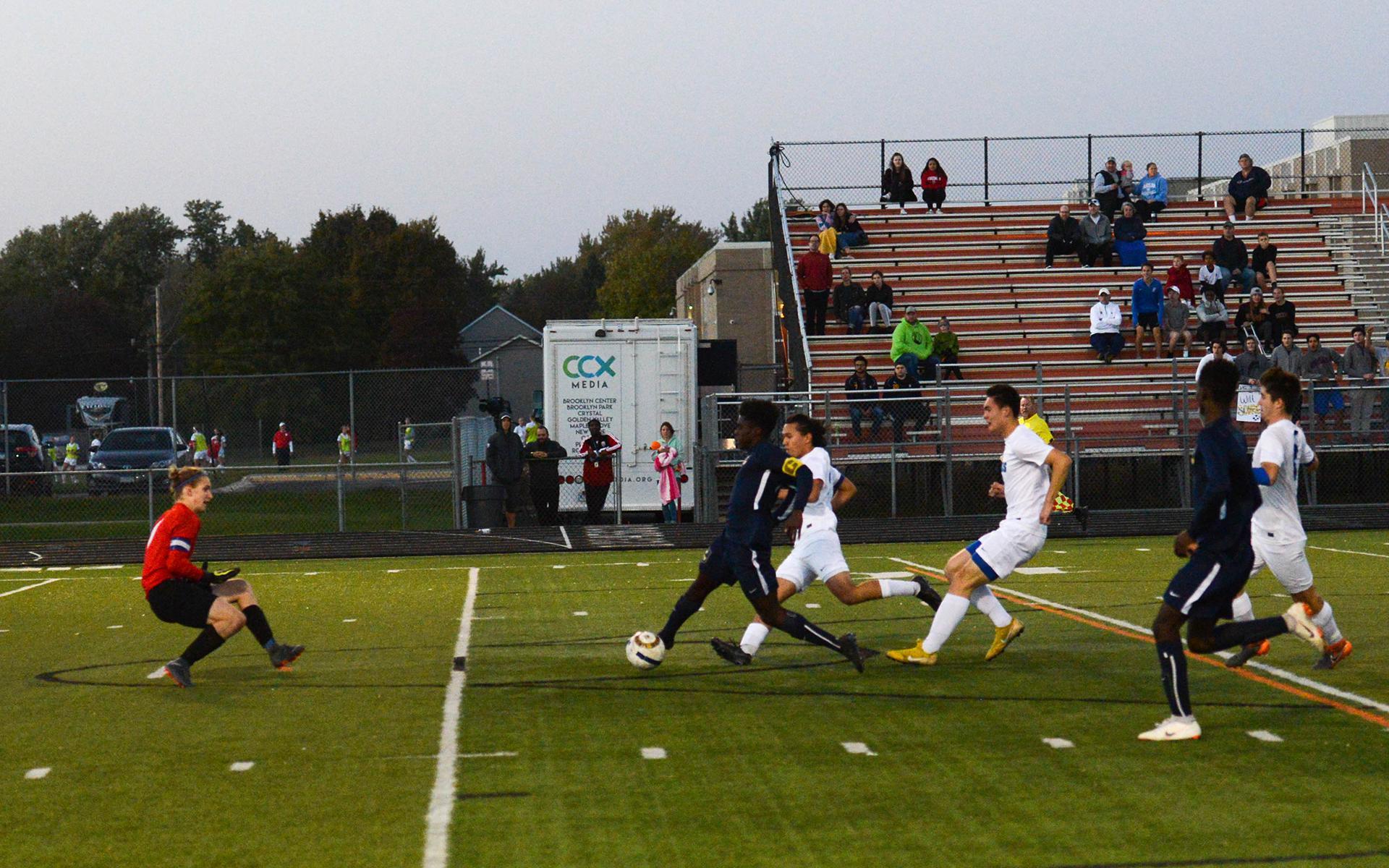 Totino-Grace forward Herbert Endeley makes a late run on goal against Blake. Photo by Carter Jones, SportsEngine