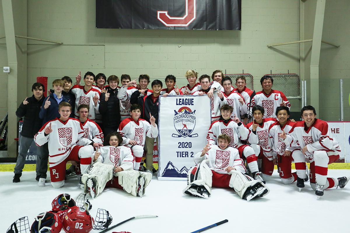 Regis Jesuit players celebrate winning the CPHL Tier 2 title on April 1. The Raiders beat Mullen 5-4 in overtime in Littleton. Photo by Katie Hinkle, SportsEngine