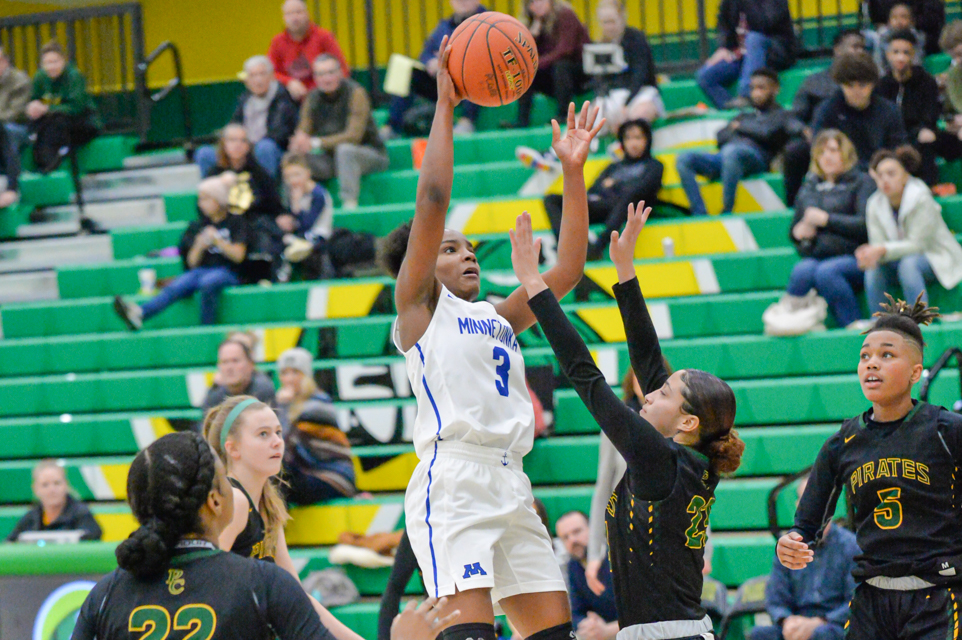 Minnetonka's Desiree Ware gets a layup early in the second half. Ware had 21 points Friday night in Minnetonka's 75-58 loss to Park Center. Photo by Earl J. Ebensteiner, SportsEngine