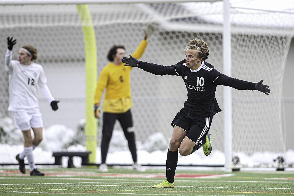 Image Caption: Riley Buxell (10) celebrates his goal with two minutes left in the first half of the Class 2A, Section 4 boys' soccer championship. It was the game's only goal in Stillwater's 1-0 victory over Park of Cottage Grove. Photo by Mark Hvidsten,