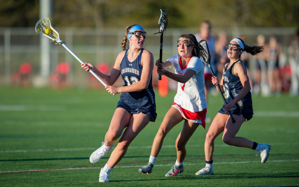 Chanhassen's Leah Hodgins (12) had eight goals Tuesday night in the Storm's 16-4 victory over conference rival Benilde-St. Margaret's. Photo by Earl J. Ebensteiner, SportsEngine