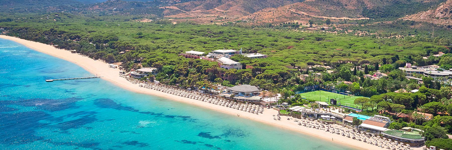 Hotels and at ennis court are surrounded by the beach and Turquoise Mediterranean Sea and small forests and parks  in Santa Mareritha di Pula in Sardinia