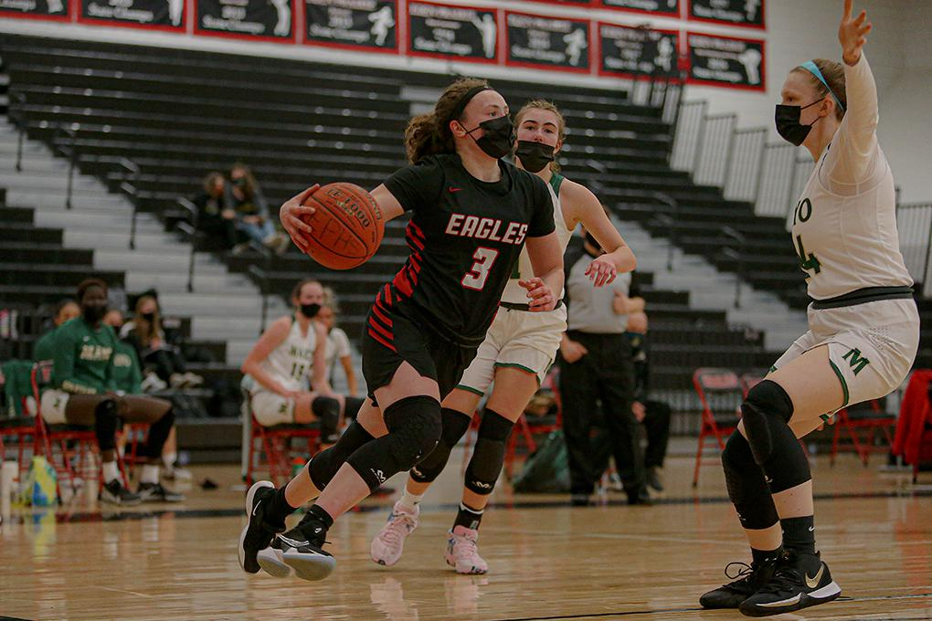 Eden Prairie's Molly Lenz (3) drives as Rochester Mayo's Mia Harber defends. Lenz scored a team-high 16 points for the Eagles. Photo by Mark Hvidsten, SportsEngine
