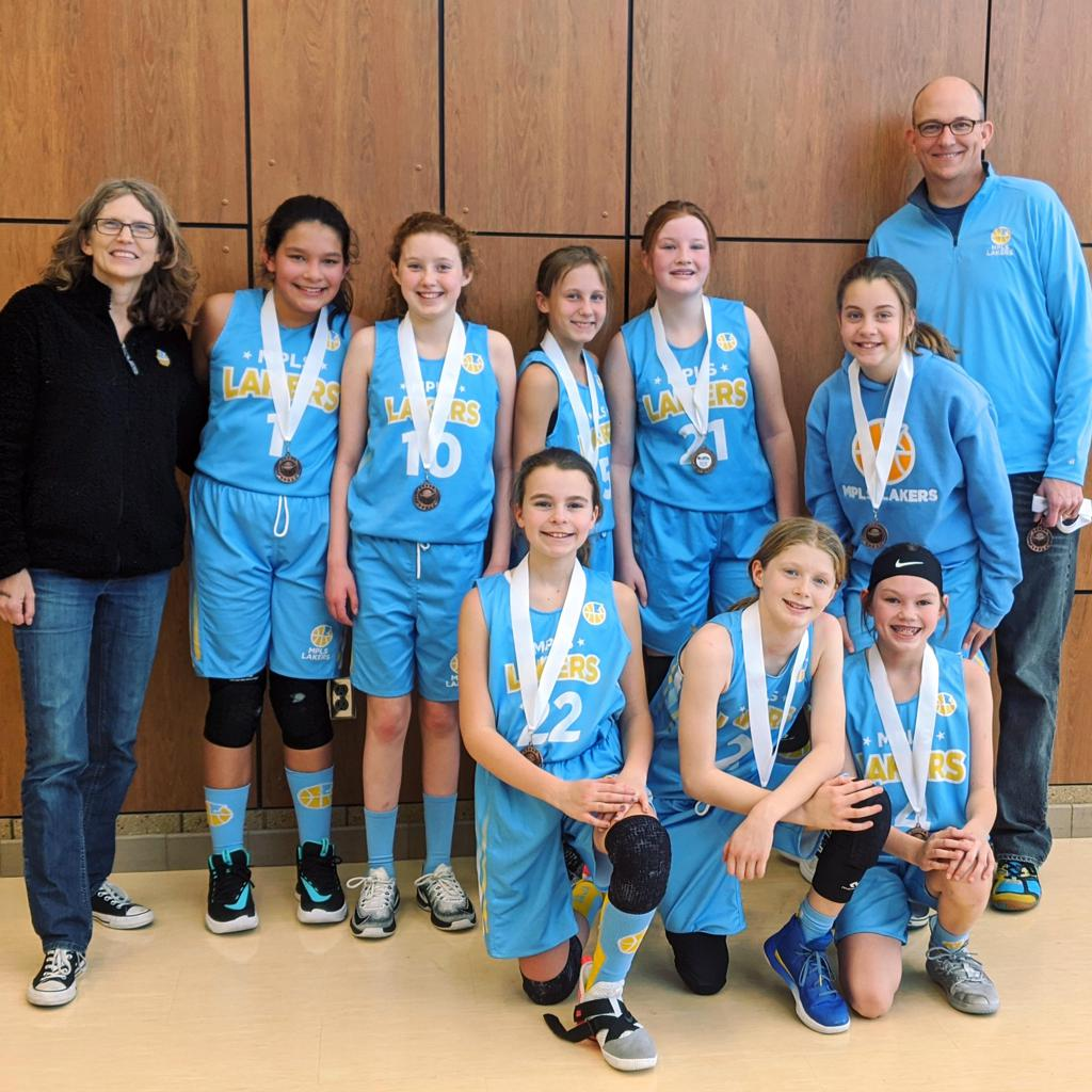 Minneapolis Lakers Girls 6th Grade Gold pose with their medals after earning 3rd place at the Rockford Girls Showcase tournament in Rockford, MN