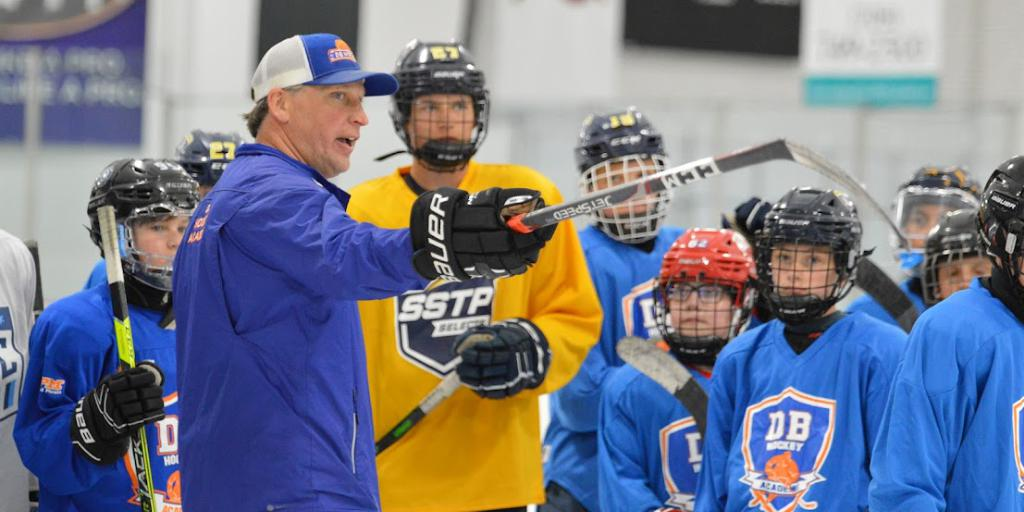 Coach Doug Bosse instructing hockey players