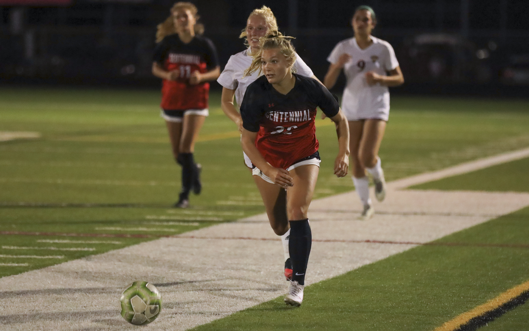 Centennial's Tatum Trettel (22) brings the ball up the sideline against Maple Grove Wednesday night. The Cougars defeated the Crimson 1-0 at Centennial High School. Photo by Jeff Lawler, SportsEngine