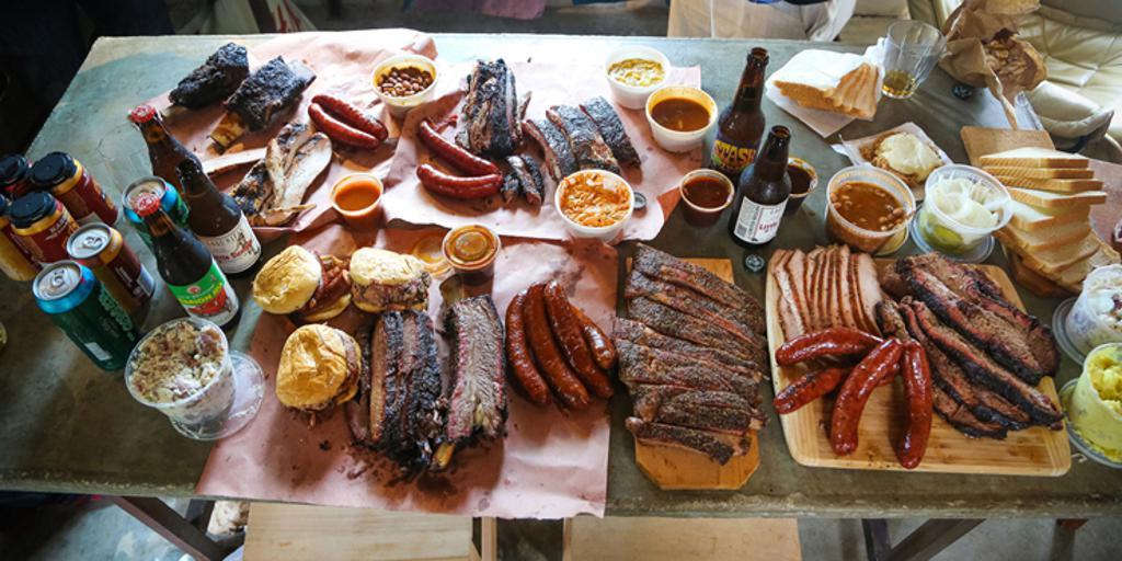 Barbeque-style food on a long table