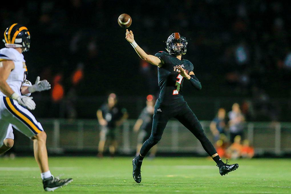 Farmington quarterback Alex Berreth (3) threw a touchdown pass late in the second quarter to pull the Tigers within 35-7 against Rosemount. Photo by Mark Hvidsten, SportsEngine