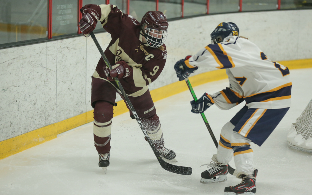 South St. Paul's Makenna Deering (9) battles with a Mahtomedi player for a loose puck in Friday night's game. Deering had a shorthanded goal in the Packers' 3-1 victory over the Zephyrs. Photo by Jeff Lawler, SportsEngine