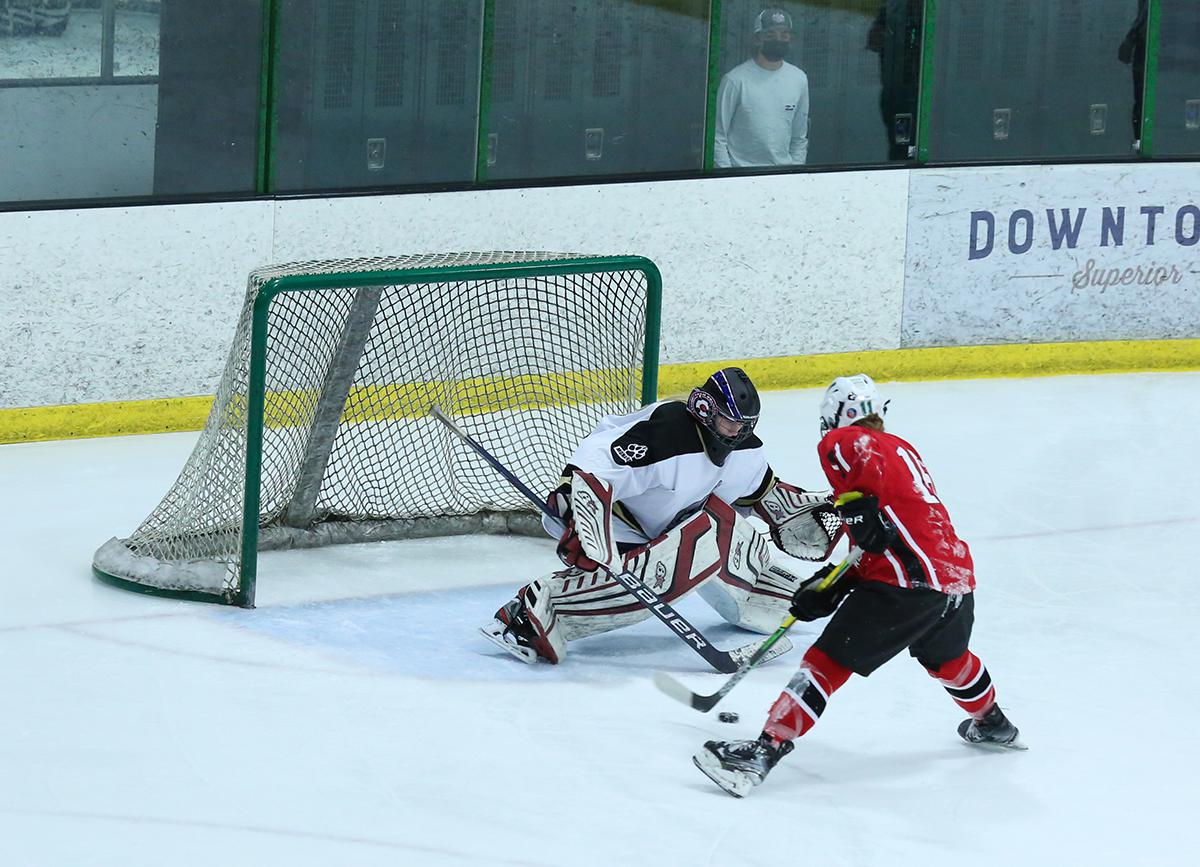 Coyotes goaltender Payton Sutherland makes one of her 20 saves during her team's 2-0 season-opening victory over the Black Widows at the Sport Stable in Superior on Friday evening. Photo by Katie Hinkle, SportsEngine