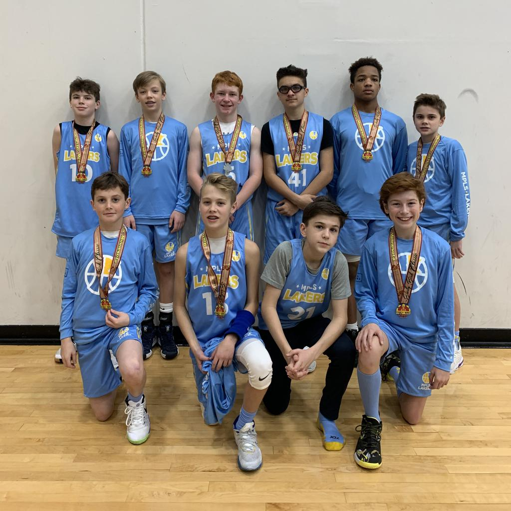 Minneapolis Lakers Boys 7th Grade Gold pose with their Medals after earning 2nd place at the Rochester Early Bird tournament in Rochester, MN