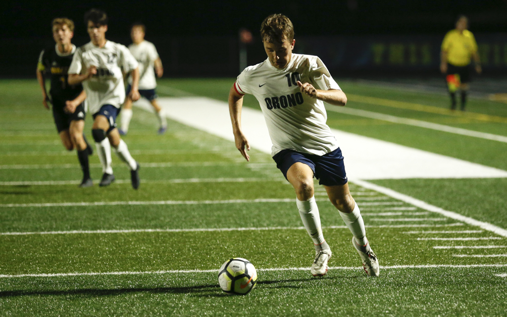 Orono's Reece Clifford (10) brings the ball in on a run leading to his second-half goal against Waconia Tuesday night. The Spartans defeated the Wildcats 2-0 in Waconia. Photo by Jeff Lawler, SportsEngine
