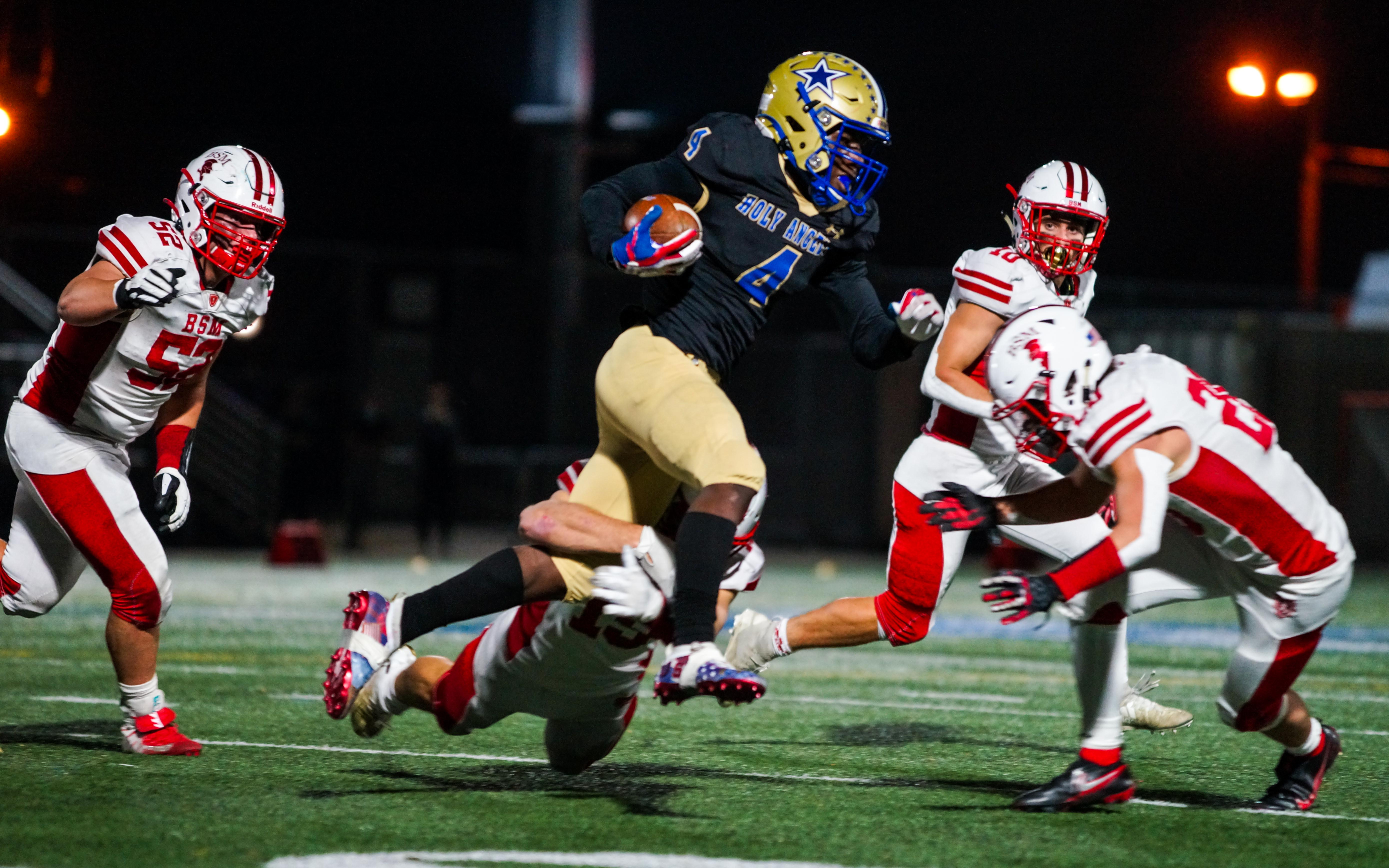 Holy Angels running back Emmett Johnson (4) had two rushing touchdowns and a two-point conversion in the Stars' 29-27 victory over Benilde-St. Margaret's Friday night. Photo by Korey McDermott, SportsEngine