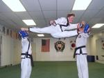 flying kick by a black belt