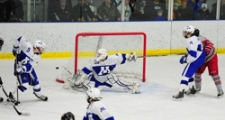 Minnetonka senior goaltender Matt Behounek made 33 saves as his team defeated top-ranked Duluth East on Saturday, Jan. 21. Photo by Adam Crane