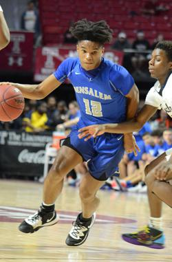 James Ashford IV dribbles the ball during the PIAA District 1 6A semifinals
