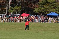 The start to a typical cross country race at Tom's River Park. Official fires gun to signal start of race.