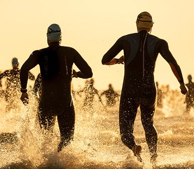 Athletes entering the ocean