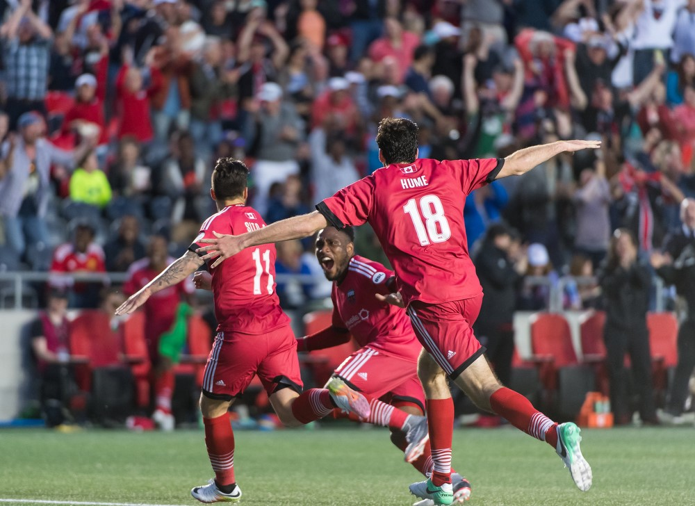 Sito, Eddie Edward and Tucker Hume celebrating after Sito's goal that gave Ottawa a 2-1 win