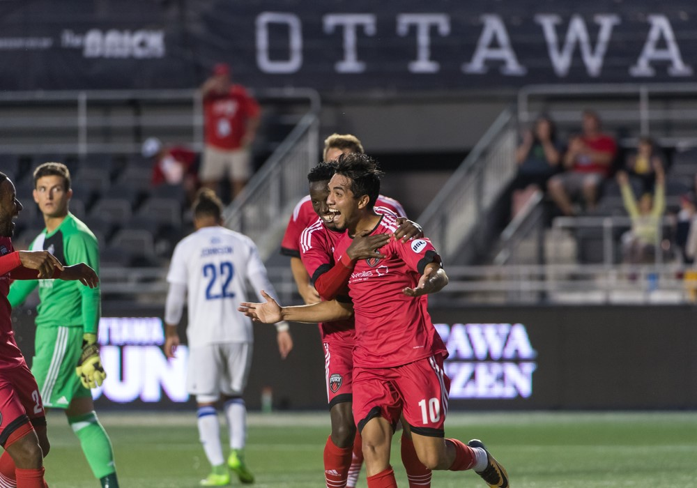 Gerardo Bruna celebrating his first goal in Fury FC colours with Azake Luboyera hugging him from the back