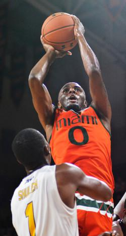Ja'Quan Newton jumps to the basket