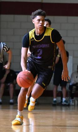 A boy dribbles a basketball